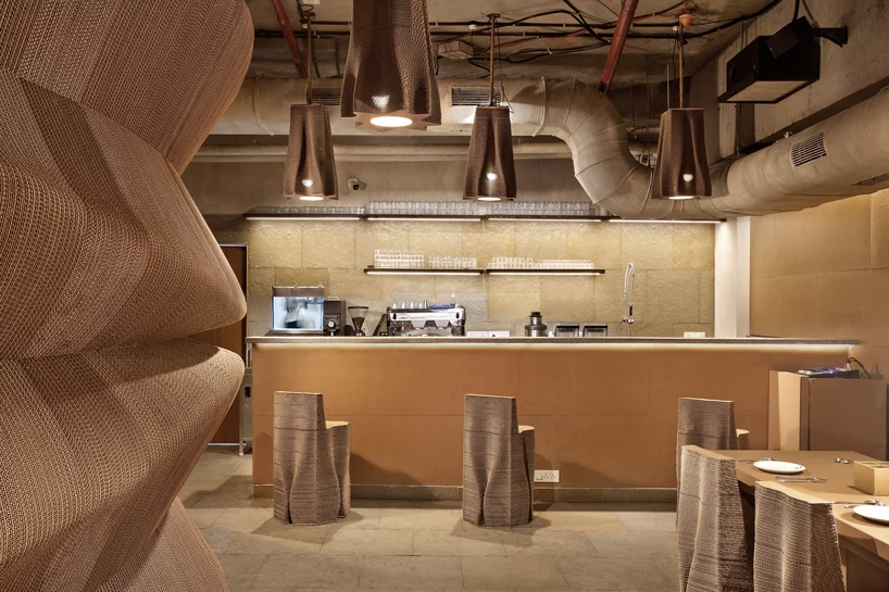 This cafe in Mumbai is made up of cardboard and 100% biodegradable material. What an amazing Idea.